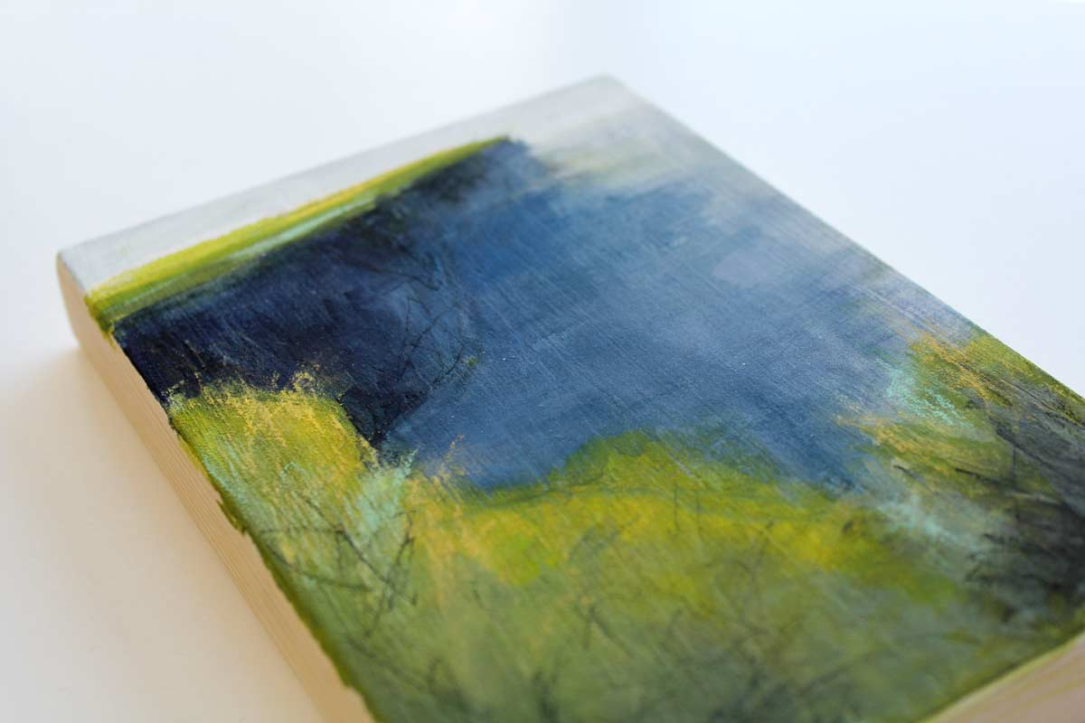 closeup of a small mixed media landscape painting inspired by the Cliffs of Moher, County Clare, Ireland