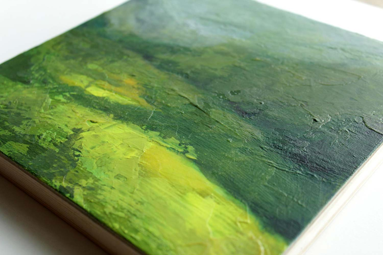 close up of a mixed media acrylic semi abstract landscape inspired by Ireland