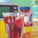 acrylic painting of a glass of red tea on a yellow kitchen counter