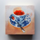 painting of an espresso in a blue and white demitasse at an italian bar